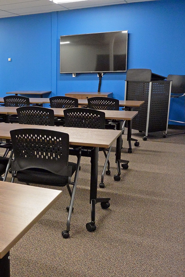 Strategic Research Associates Federal Way Facility Blue Oversized Focus Group Room with Classroom style seating